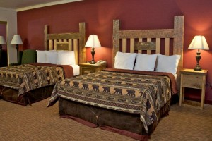 Three Bear Lodge - superb motel rooms :: Lodge rooms with hand-made furniture, newly renovated motel, conference center, luxury suites and popular restaurant. Yellowstone tours & snowmobile rentals in winter.