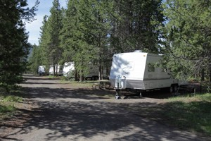 Headwaters Lodge & Cabins at Flagg Ranch :: 2 miles to Yellowstone Park's South Gate. Camper Cabins, RV sites, & tent camping. The most convenient location to explore Yellowstone Park, Grand Teton Park & Jackson Hole.